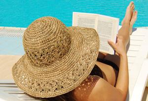 201106-omag-summer-reading-pool-300x205