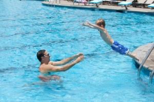 kid-jumping-pool