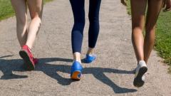 women-walking-texting-main