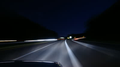 stock-footage-night-driving-on-a-country-highway