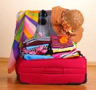 stock-photo-39293734-open-red-suitcase-with-clothing-in-the-room